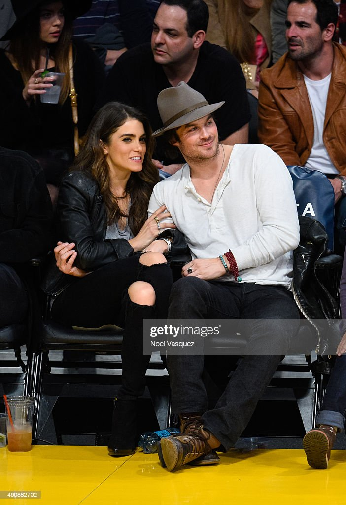 Ian Somerhalder (R) and Nikki Reed attend a basketball game between the Phoenix Suns and the Los Angeles Lakers at Staples Center on December 28, 2014 in Los Angeles, California.
