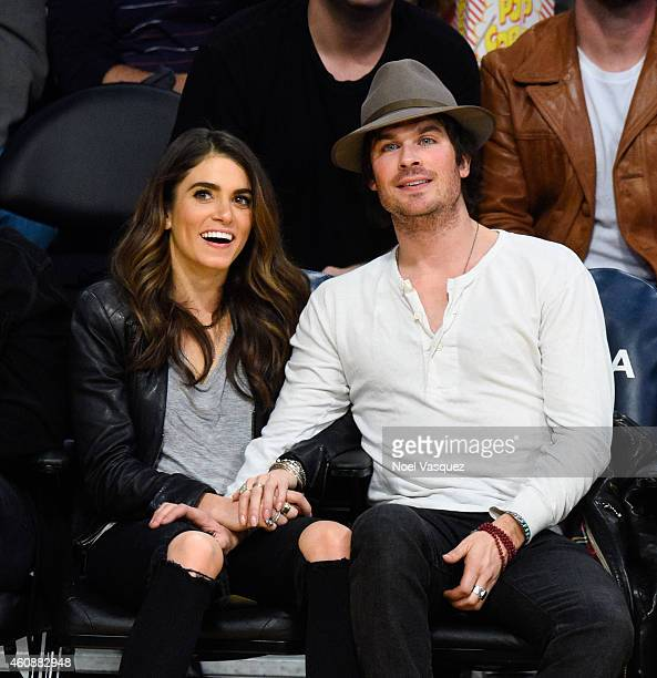 Ian Somerhalder and Nikki Reed attend a basketball game between the Phoenix Suns and the Los Angeles Lakers at Staples Center on December 28 2014 in...