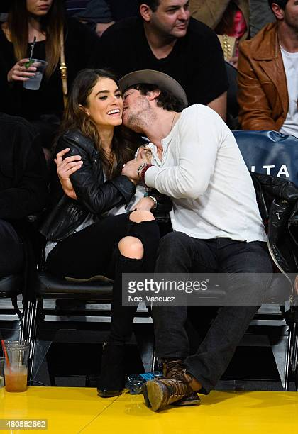 Ian Somerhalder and Nikki Reed kiss at a basketball game between the Phoenix Suns and the Los Angeles Lakers at Staples Center on December 28 2014 in...