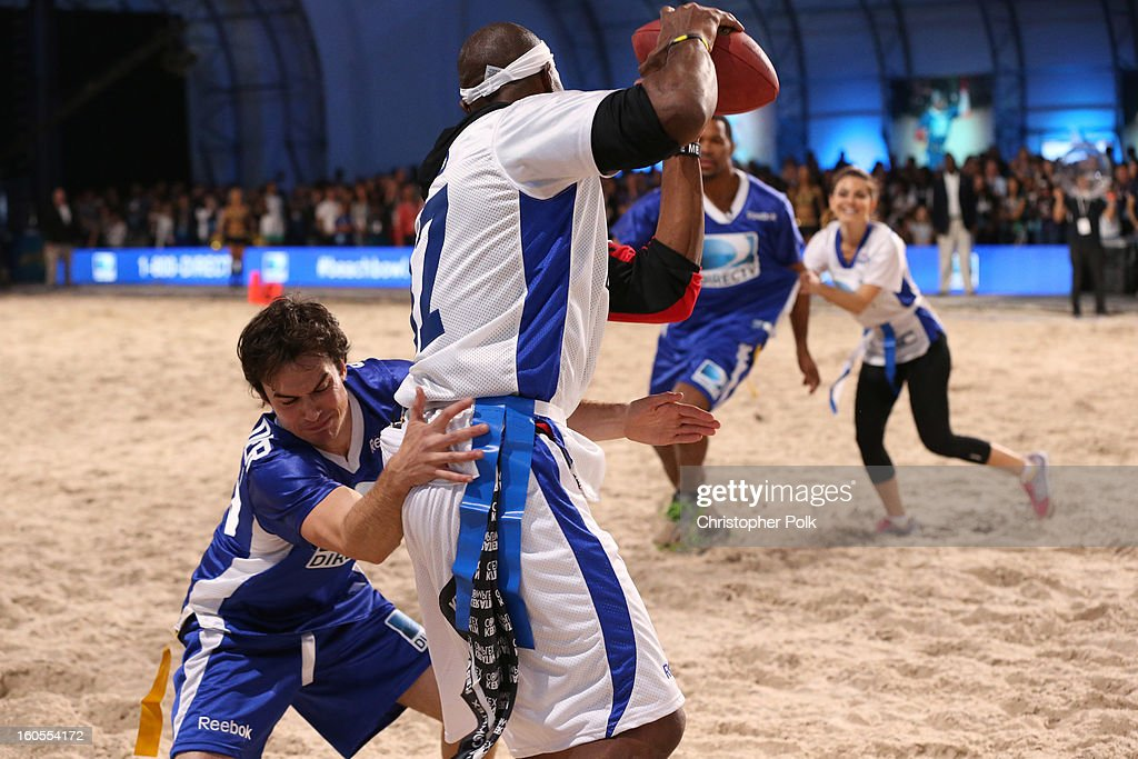 Ian Somerhalder and Terrell Owens attend DIRECTV'S Seventh Annual Celebrity Beach Bowl at DTV SuperFan Stadium at Mardi Gras World on February 2, 2013 in New Orleans, Louisiana.