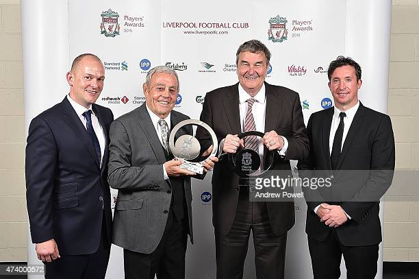 Ian St John and Ron Yeats former players of Liverpool pose for a photograph with Robbie Fowler and Mark Bowman after winning the Lifetime Achievement...