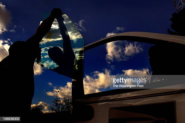 Ian Stewart a glass installer replaces the side window of a mail truck that had several broken windows He works for GlasFill in Laurel MD Overnight...