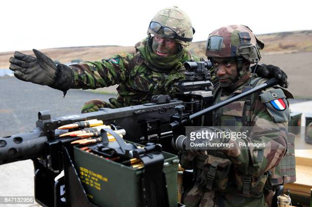 Ian Stewart from 5 Scots and a solider of the French Army Parachute Company from the French 11th Parachute Brigade taking part in Boars Head a joint...