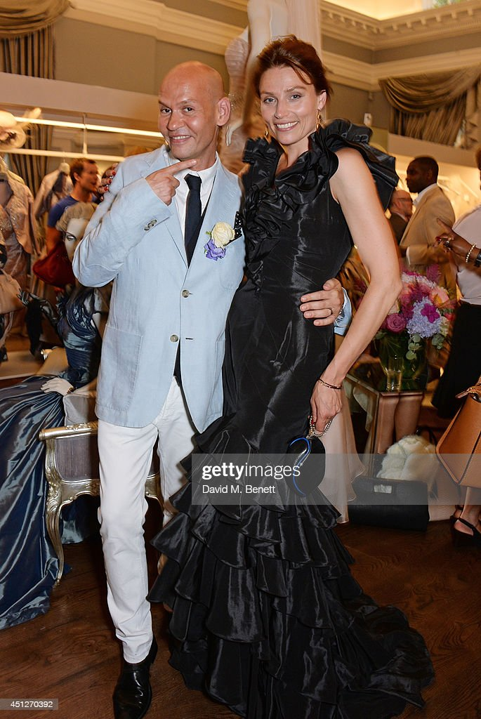 Ian Stuart Blewcoat (L) and model Shalke Gummels pose at the Ian Stuart Blewcoat store opening on June 26, 2014 in London, England.