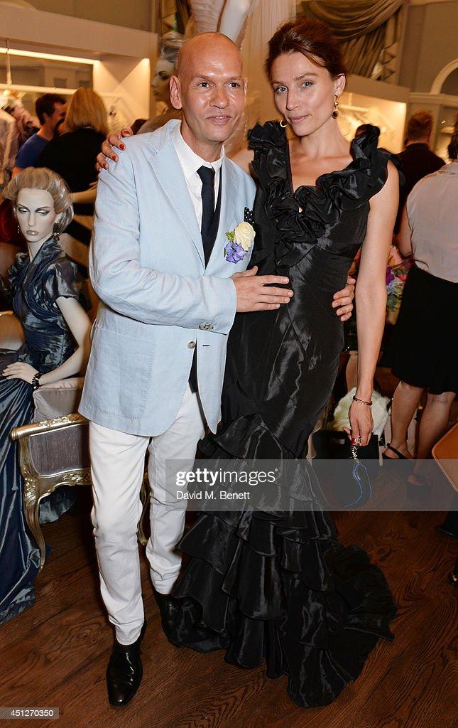 Ian Stuart Blewcoat (L) and model Shalke Gummels pose with models at the Ian Stuart Blewcoat store opening on June 26, 2014 in London, England.