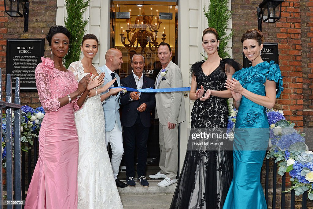 Ian Stuart Blewcoat, David Sassoon and Peter Tague pose with models at the Ian Stuart Blewcoat store opening on June 26, 2014 in London, England.