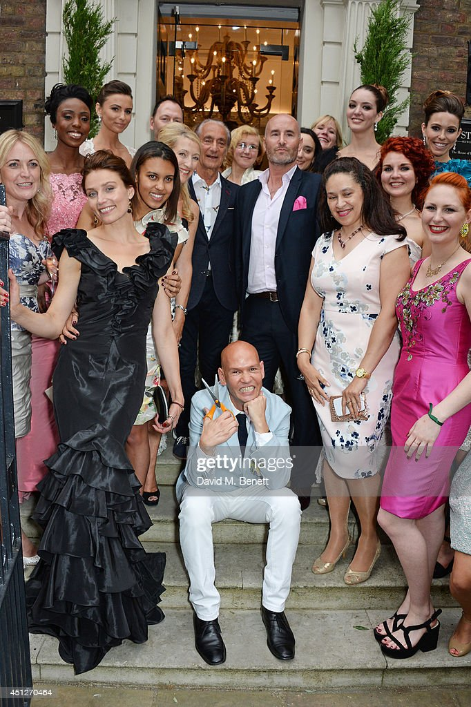 Ian Stuart Blewcoat (front C) poses with guests including David Sassoon, Peter Tague and Shalke Gummels to celebrate the Ian Stuart Blewcoat store opening on June 26, 2014 in London, England.