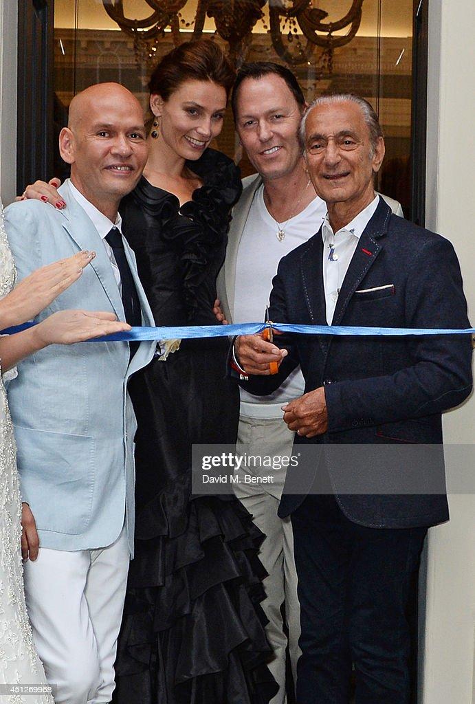 Ian Stuart Blewcoat, Shalke Gummels, Peter Tague and David Sassoon pose with models at the Ian Stuart Blewcoat store opening on June 26, 2014 in London, England.