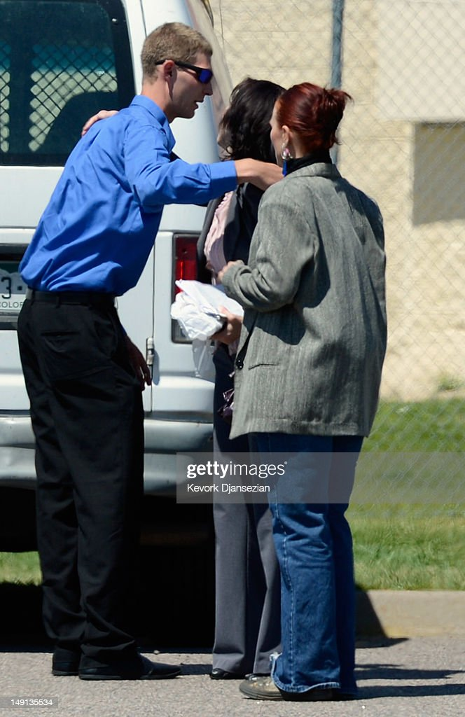 Ian Sullivan, father of six-year-old Veronica Moser, the youngest victim of the theater shooting, speaks with couple of women in parking lot in front of the Arapahoe County Detention Center after attending the first court hearing for alleged Century 16 movie theater shooter at the Arapahoe County Courthouse on July 23, 2012 in Centennial, Colorado. James Holmes, 24, is accused of killing 12 people and injured 58 others during a shooting rampage at an opening night screening of 'The Dark Knight Rises', in Aurora, Colorado.