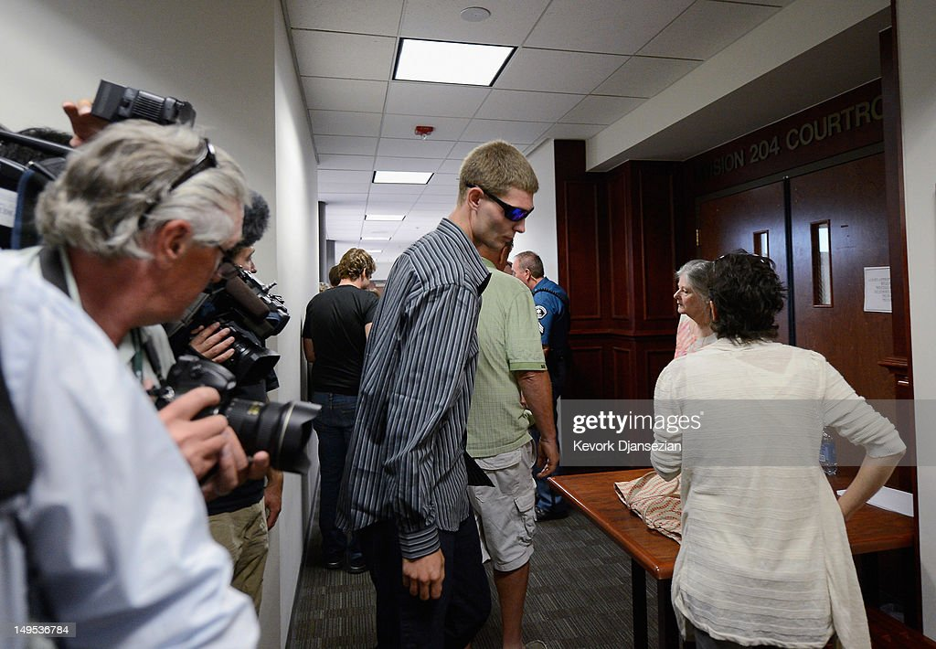Ian Sullivan (C), father of six-year-old Veronica Moser, the youngest victim of the theater shooting, arrives at the Arapahoe County Courthouse for the arraignment of accused theater gunman James Holmes July 30, 2012 in Centennial, Colorado. Holmes is charged with 24 counts of murder and 116 counts of attempted murder in the July 20, shooting rampage at an opening night screening of 'The Dark Knight Rises' in Aurora, Colorado.