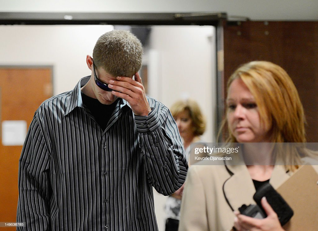 Ian Sullivan (L), father of six-year-old Veronica Moser, the youngest victim of the theater shooting, arrives at the Arapahoe County Courthouse for the arraignment of accused theater gunman James Holmes July 30, 2012 in Centennial, Colorado. Holmes is charged with 24 counts of murder and 116 counts of attempted murder in the July 20, shooting rampage at an opening night screening of 'The Dark Knight Rises' in Aurora, Colorado.