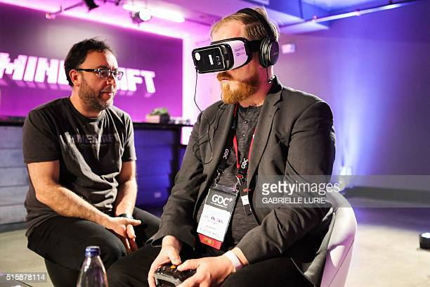 Ian Tingen of UploadVR wears Oculus goggles while experiencing the Minecraft for Gear VR at The Village event space in San Francisco California on...