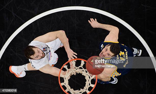 Ian Vougioukas of Ulm and Marko Banic of Berlin look for the ball during the Beko Basketball Bundesliga match between Ratiopharm Ulm and Alba Berlin...