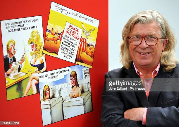 Ian Wallace with a poster showing some of his collection of saucy postcards from the Bamforth vintage card collection which celebrates its 100th...