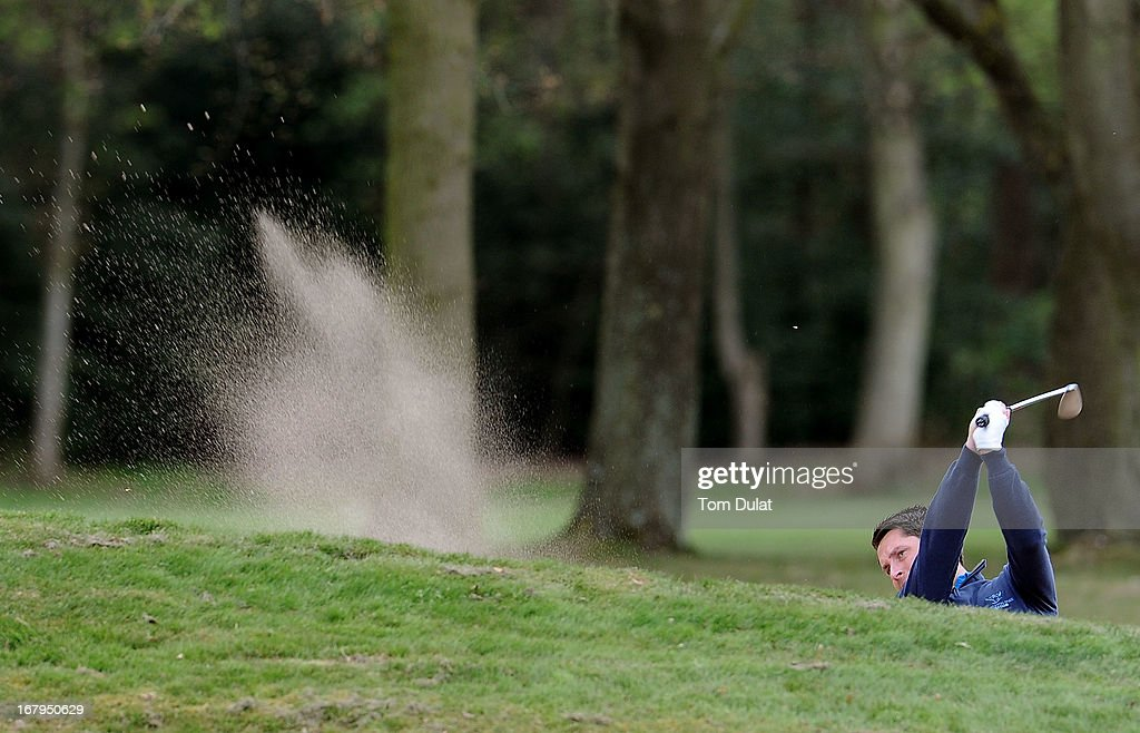 Ian Walley of Kedleston Park Golf Club plays out the bunker on the 2nd hole during the Glenmuir PGA Professional Championship Midland Region Qualifier at Little Aston Golf Club on May 03, 2013 in Sutton Coldfield, England.