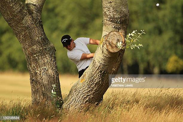 Ian Walley of Shirland Golf Club plays a shot from behind a tree on the 8th hole during the Virgin Atlantic PGA National ProAm Championship Regional...