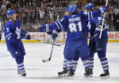 Ian White and Phil Kessel of the Toronto Maple Leafs celebrate a second period goal against the Washington Capitals during game action December 12...