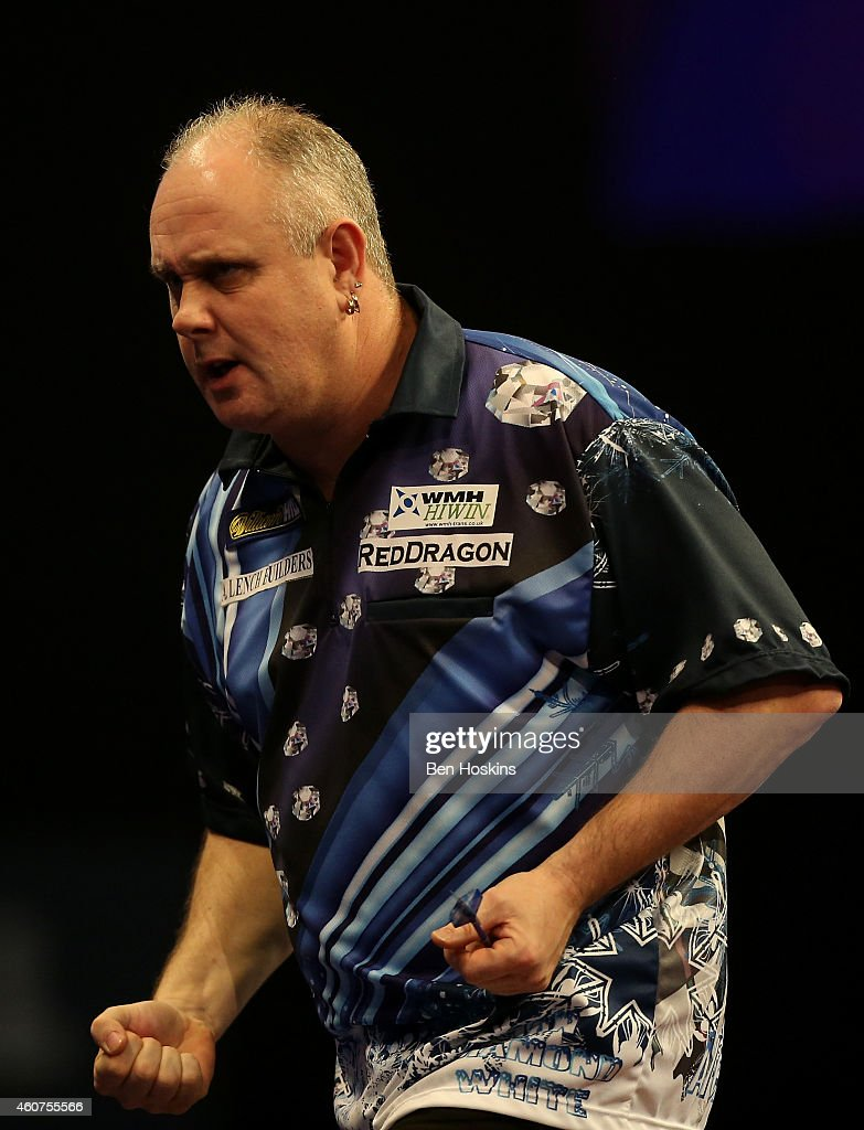 Ian White of England celebrates winning a set during his first round match against John Michael of Greece on day four of the 2015 William Hill PDC...