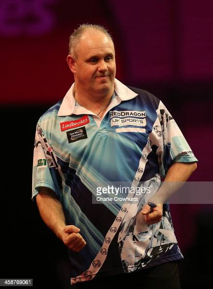 Ian White of England celebrates winning a set during his second round match against Kim Huybrechts of Belgium during the Ladbrokescom World Darts...