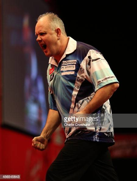 Ian White of England celebrates winning his first round match against Kyle Anderson of Australia during on Day Two of the Ladbrokescom World Darts...