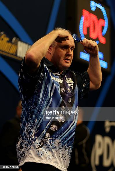 Ian White of England celebrates winning his first round match against John Michael of Greece on day four of the 2015 William Hill PDC World Darts...