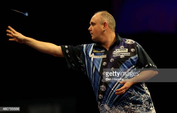 Ian White of England in action during his first round match against John Michael of Greece on day four of the 2015 William Hill PDC World Darts...