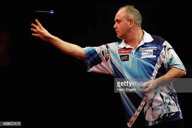 Ian White of England in action during his quarter final match against Simon Whitlock of Australia on day thirteen of the Ladbrokescom World Darts...
