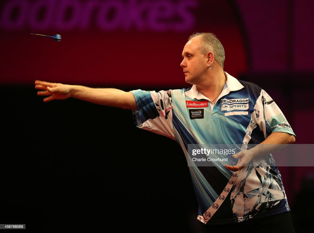 Ian White of England in action during his second round match against Kim Huybrechts of Belgium during the Ladbrokescom World Darts Championship on...