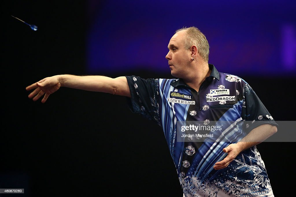 Ian White of England in action during his second round match against Kim Huybrechts of Belgium on Day Eight of the William Hill PDC World Darts...