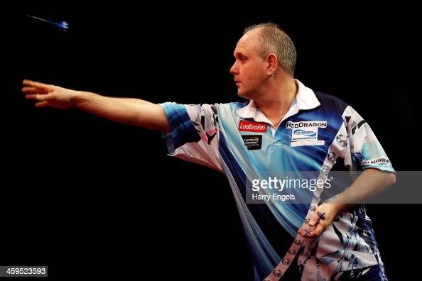 Ian White of England in action during his third round match against Richie Burnett of Wales on day twelve of the Ladbrokescom World Darts...