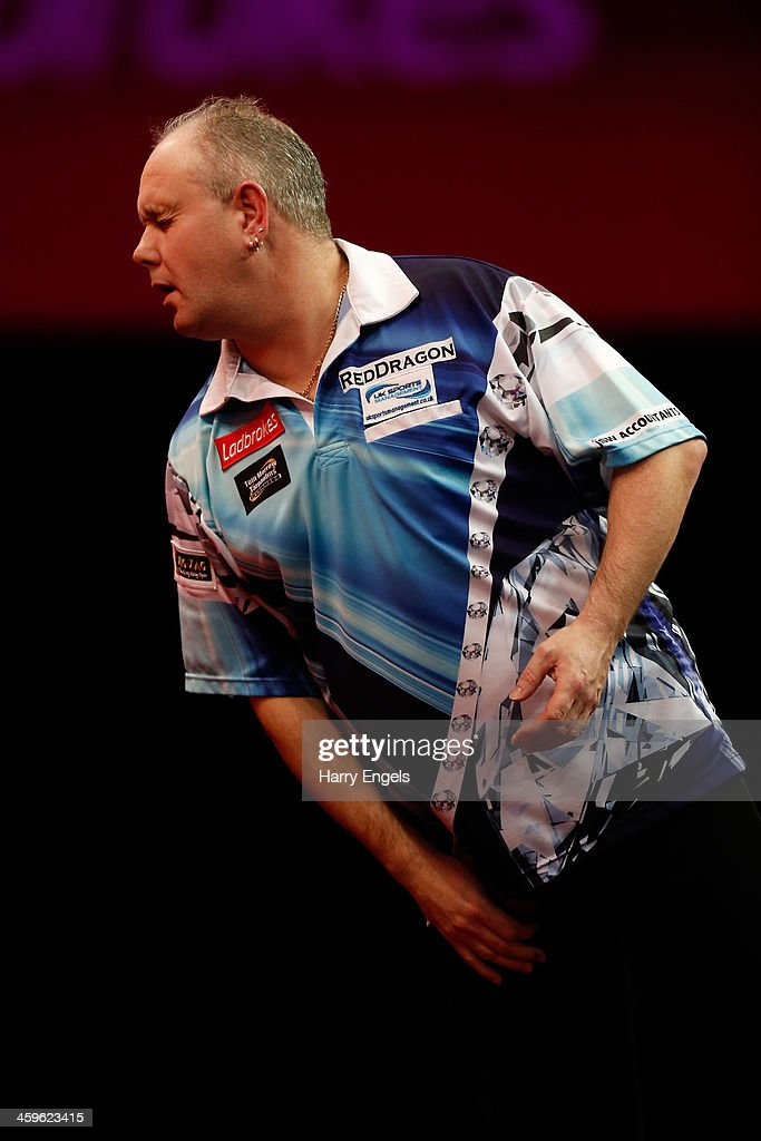 Ian White of England looks dejected during his quarter final match against Simon Whitlock of Australia on day thirteen of the Ladbrokescom World...