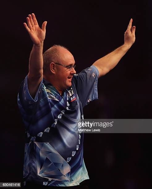 Ian White of Great Britain celebrates his win against Jonny Clayton of Great Britain during day nine of the 2017 William Hill PDC World Darts...
