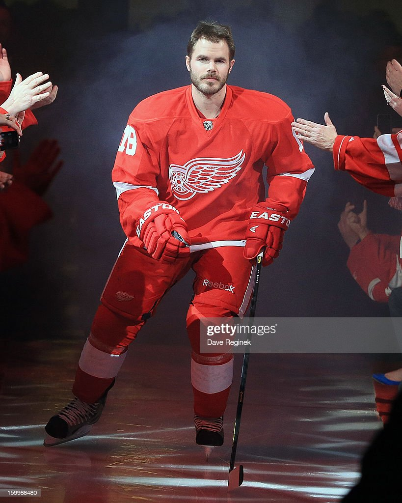 Ian White #18 of the Detroit Red Wings is introduced in pre-game ceramonies before an NHL game against the Dallas Stars at Joe Louis Arena on January 22, 2013 in Detroit, Michigan. Dallas won 2-1