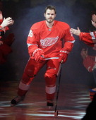 Ian White of the Detroit Red Wings is introduced in pregame ceramonies before an NHL game against the Dallas Stars at Joe Louis Arena on January 22...