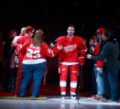 Ian White of the Detroit Red Wings is introduced prior to playing the Dallas Stars at Joe Louis Arena on January 22 2013 in Detroit Michigan