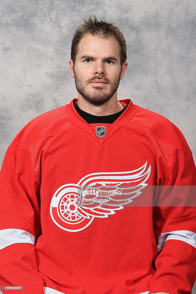 Ian White #18 of the Detroit Red Wings poses for his official headshot for the 2012-2013 season at Compuware Ice Arena on January 13, 2013 in Plymouth, Michigan.