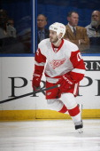 Ian White of the Detroit Red Wings skates against the St Louis Blues in an NHL game on January 19 2013 at Scottrade Center in St Louis Missouri