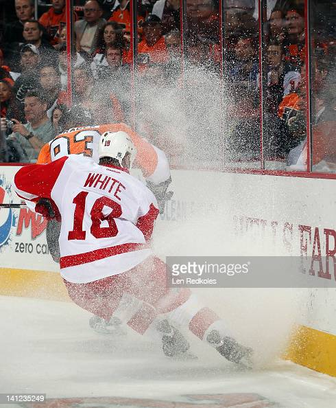 Ian White of the Detroit Red Wings skates alongside the boards against Jakub Voracek of the Philadelphia Flyers on March 6 2012 at the Wells Fargo...
