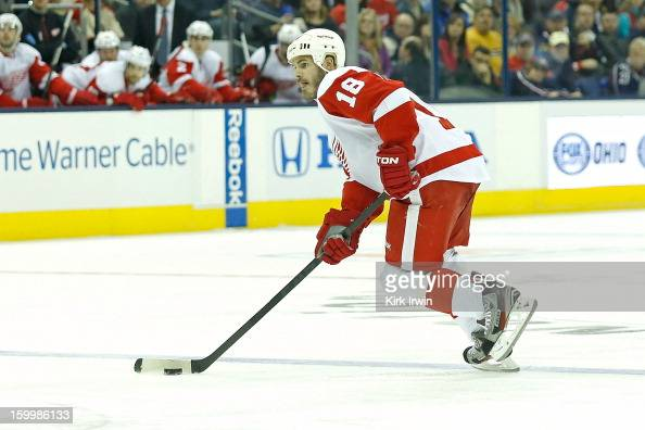 Ian White of the Detroit Red Wings skates with the puck during the game against the Columbus Blue Jackets on January 21 2013 at Nationwide Arena in...