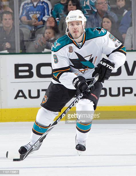 Ian White of the San Jose Sharks handles the puck against the Dallas Stars at the American Airlines Center on March 15 2011 in Dallas Texas