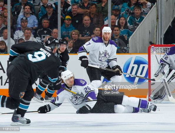 Ian White of the San Jose Sharks takes a shot against Michal Handzus Rob Scuderi and Jonathan Quick of the Los Angeles Kings in Game 5 of the Western...