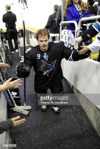 Ian White of the San Jose Sharks walking into the locker room shaking hands with fans after warming up before an NHL hockey game against the Detroit...