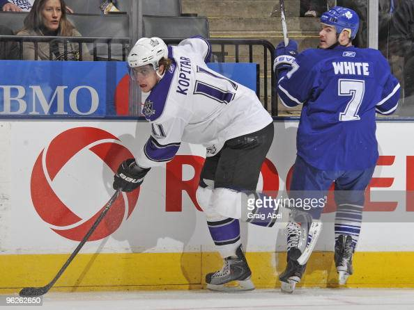Ian White of the Toronto Maple Leafs battles with Anze Kopitar of the Los Angeles Kings during the game on January 26 2010 at the Air Canada Centre...