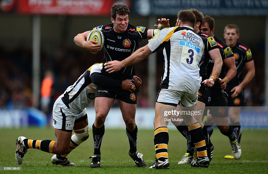 Ian Whitten of Exeter Chiefs is tackled by Charles Piutau and Lorenzo Cittadini of Wasps during the Aviva Premiership match between Exeter Chiefs and Wasps at Sandy Park on May 01, 2016 in Exeter, England.