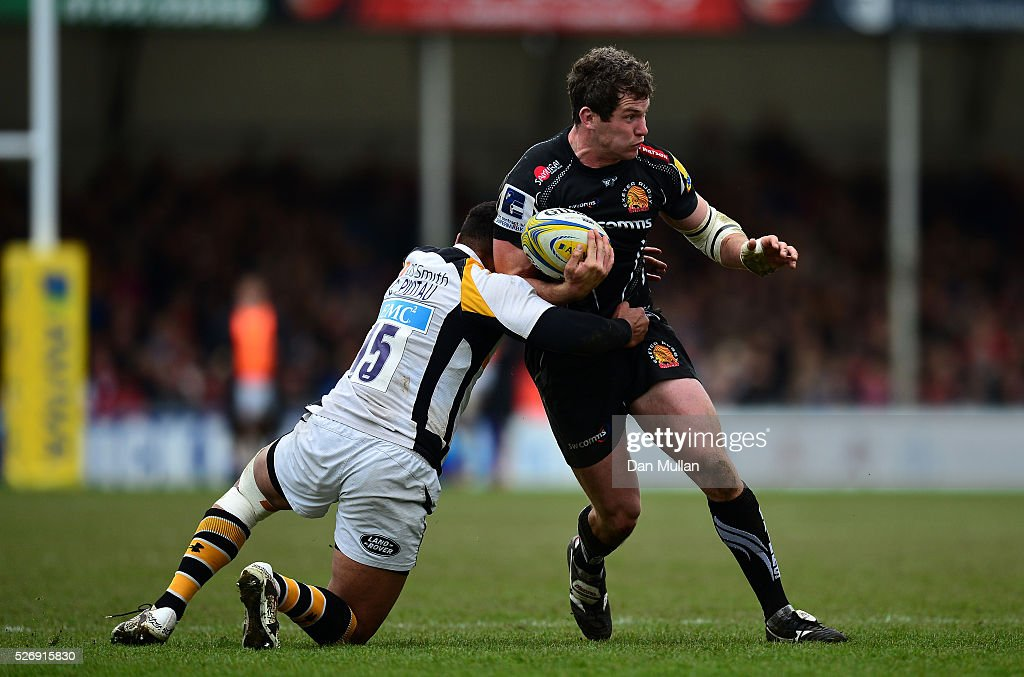 Ian Whitten of Exeter Chiefs is tackled by Charles Piutau of Wasps during the Aviva Premiership match between Exeter Chiefs and Wasps at Sandy Park on May 01, 2016 in Exeter, England.
