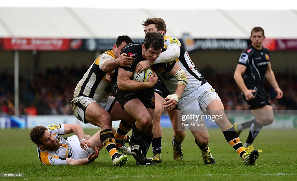 Ian Whitten of Exeter Chiefs is tackled by George Smith and <a gi-track='captionPersonalityLinkClicked' href=/galleries/search?phrase=Elliot+Daly&family=editorial&specificpeople=6751828 ng-click='$event.stopPropagation()'>Elliot Daly</a> of Wasps during the Aviva Premiership match between Exeter Chiefs and Wasps at Sandy Park on May 01, 2016 in Exeter, England.