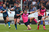 Ian Whitten of Exeter Chiefs powers his way through the challenge of Sam Warburton of Cardiff Blues as Alex Cuthbert looks on of Cardiff Bluestch...