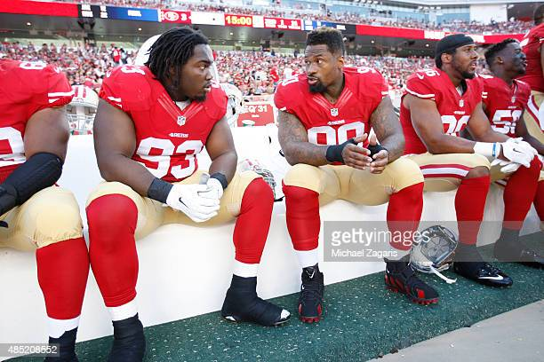 Ian Williams and Darnell Dockett of the San Francisco 49ers talk on the bench during the game against the Dallas Cowboys at Levi Stadium on August 23...