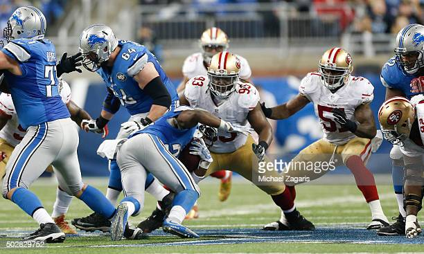 Ian Williams and Gerald Hodges of the San Francisco 49ers stop Theo Riddick of the Detroit Lions during the game at Ford Field on December 27 2015 in...