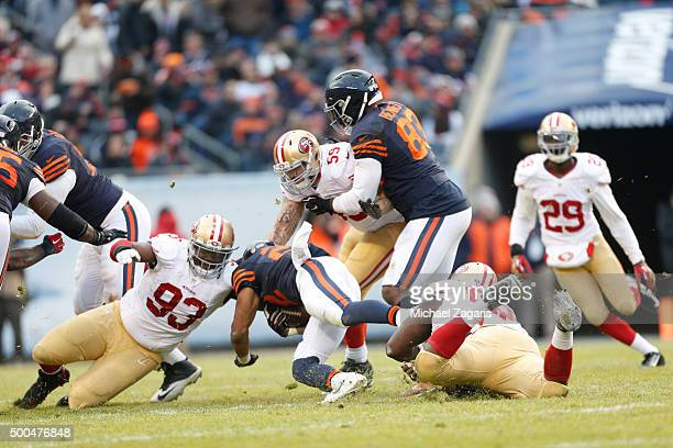 Ian Williams Quinton Dial and Aaron Lynch of the San Francisco 49ers team up to stop Matt Forte of the Chicago Bears during the game at Soldier Field...